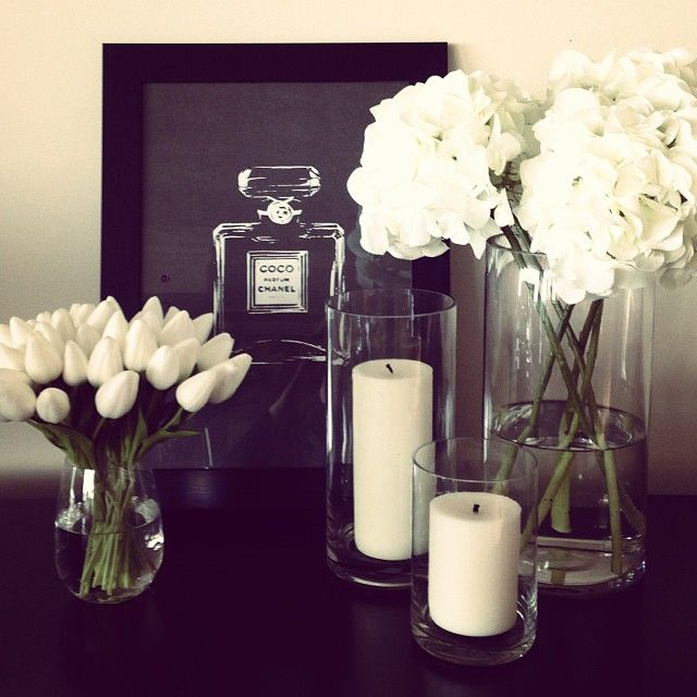 J'adore, love 'abode australia's' tulips and hydrangeas styled with simple pillar candles and Coco Chanel print. www.abodeaustralia.com