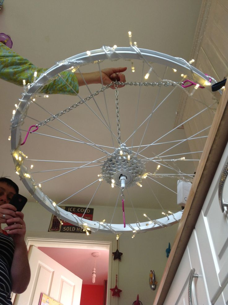 Bike light ;) so east to do and not time consuming, bike wheel, spary paint lights, 4 hooks 3 chains 40cm lengths  andahappy customer ;)