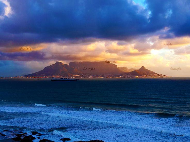For non sample image click on the image. Unique image of Table Mountain in Cape Town South Africa at eye level.  Gap in the clouds allowed for unique lighting over the mountain.