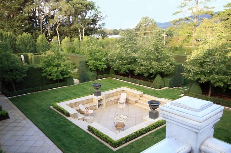 Lawn serves as a frame to dramatic sunken patio (Paul Bangay).