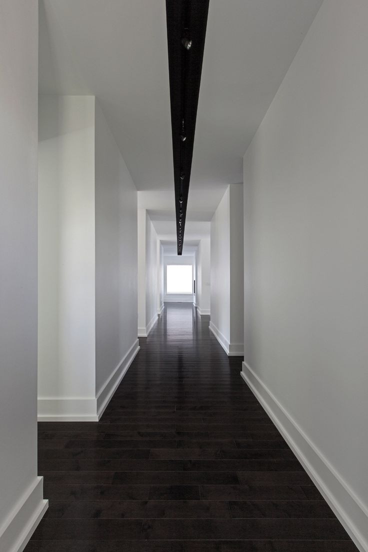 Deep Wood Floors Clean White Walls Simple Modern Baseboards And A Central Lign Of
