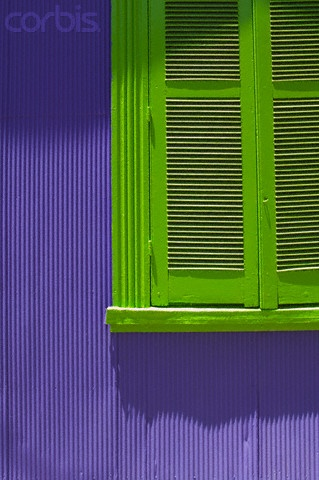 think I could talk Ryan into this one? Lime green shutters on lavender house!