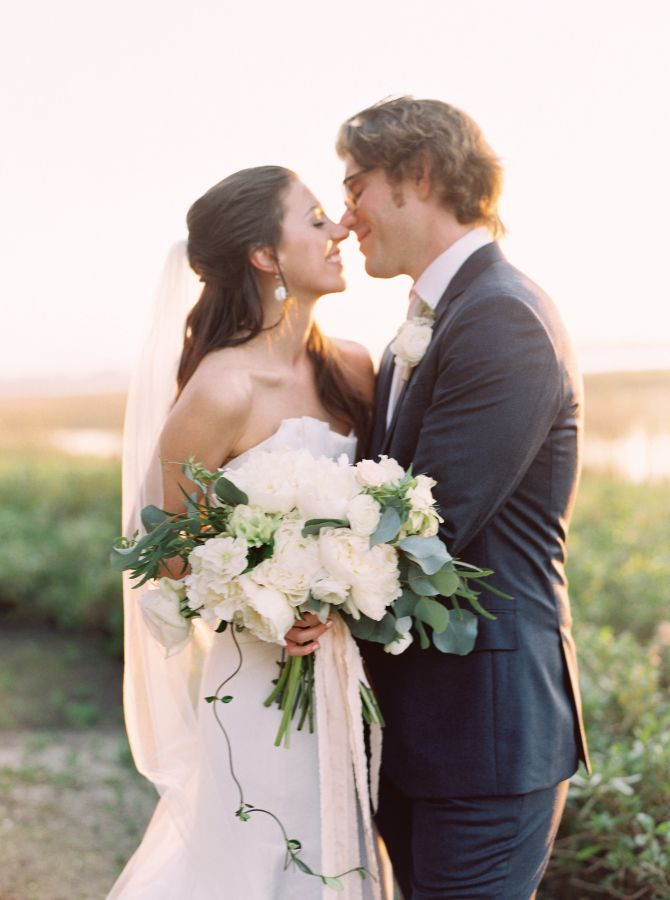 Kiss during the sunset: http://www.stylemepretty.com/south-carolina-weddings/charleston/2016/09/08/charleston-outdoor-intimate-wedding-at-the-river-house/ Photography: Sarah Joelle - http://www.sarahjoellephotography.com/