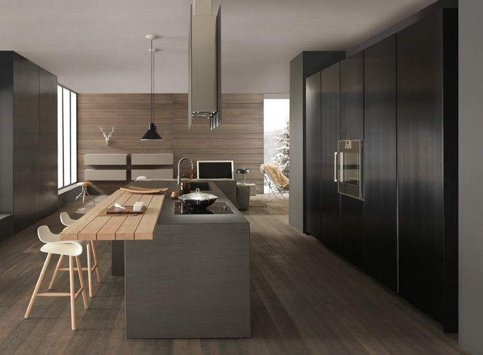 Kitchen @ DesignSpaceLondon. Floor to ceiling units with built in appliances, island with hob, sink and breakfast bar