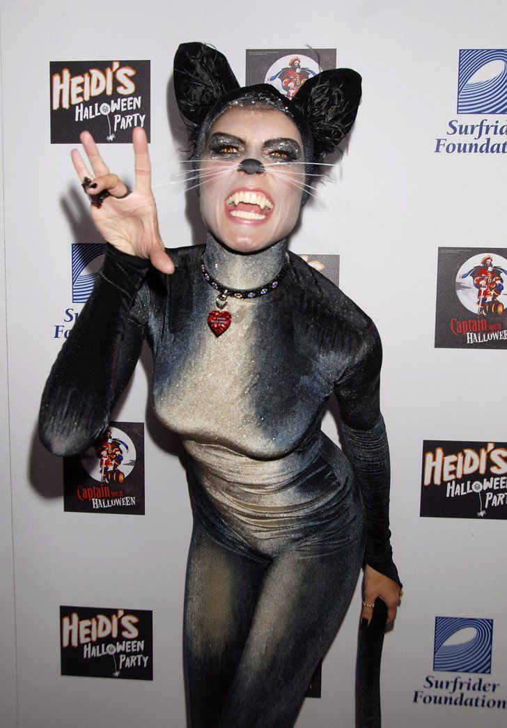 Pin for Later: 90 Cute, Crazy, and Creepy Celebrity Halloween Costumes  Heidi Klum got catty for her 2007 costume party in LA.