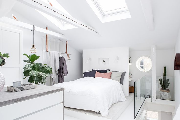 White attic bedroom with skylight
