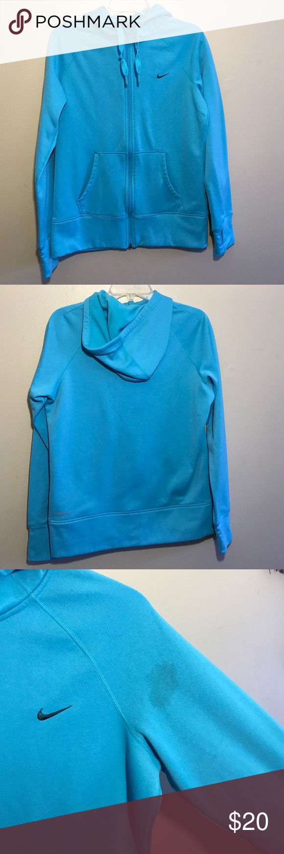 Nike Therma Fit women's zip up hoodie size M This women's Nike hoodie is in overall great wearing condition! I only wore it a couple times and washed once. Only flaw is that it somehow got stained on the left sleeve, shown in third photo. Other than that, it's in great condition! Draw strings on hoodie never pulled or adjusted, has thumb holes, 2 front pockets. Color is a bright baby blue. Color in photo picks up a little darker than actual color in person. Gorgeous color though! Nike…