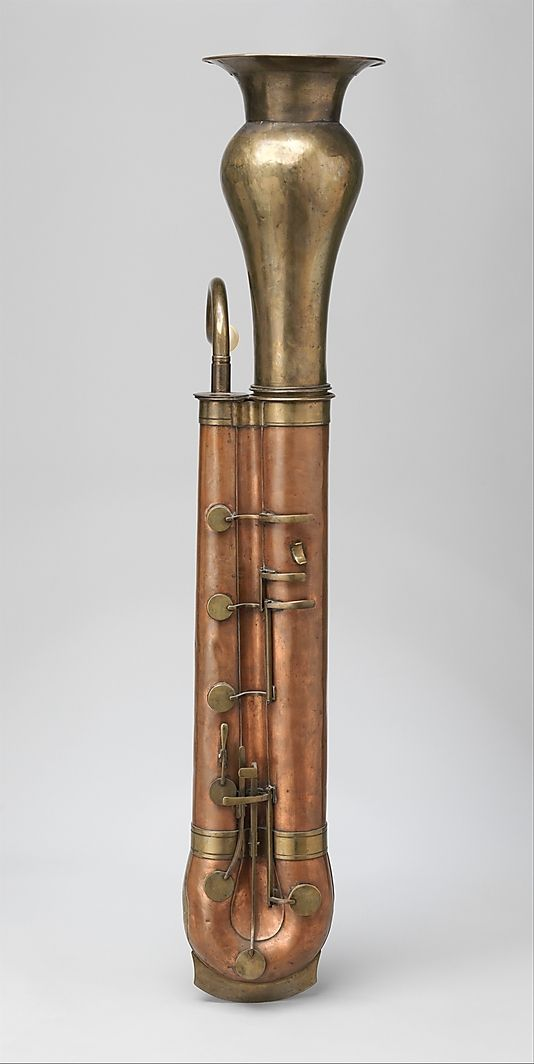 Chromatic Bass Horn, made of Copper and Brass, resembles a metal bassoon body with trombone mouthpiece