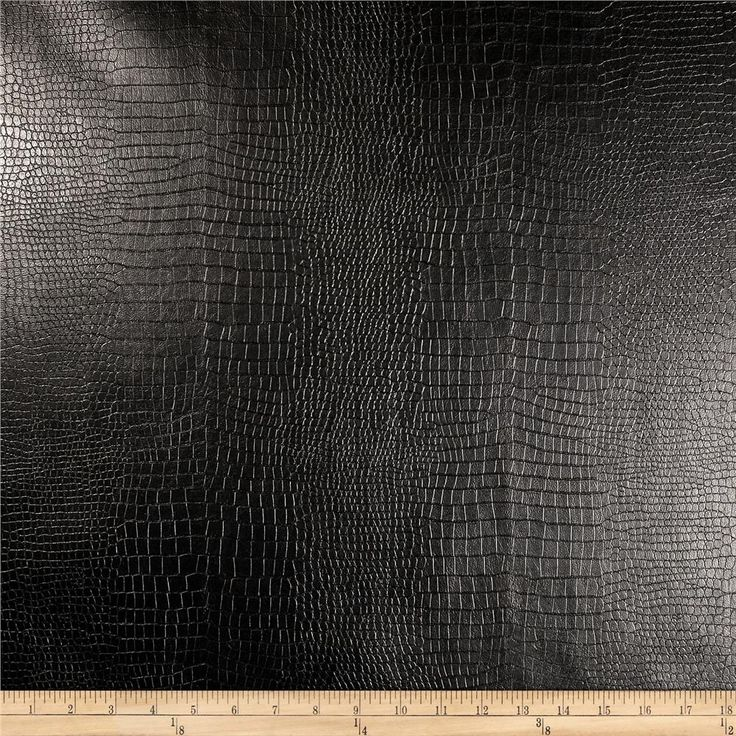 """Richloom Faux Leather Reptile Black from @fabricdotcom  This upholstery weight faux leather fabric has a soft flannel backing and an embossed face. This supple faux leather can be used for upholstery projects, picture frames, pillows, headboards craft projects, purses, fashion accessories and more!  California residents click <a href=""""http://prop65.fabric.com/"""">here</a> for Proposition 65 information."""