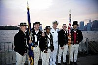 Chief of Naval Operations (CNO) Adm. Jonathan Greenert poses for a photo with the color guard of USS Constitution at the USO New York City Fleet Week block party.