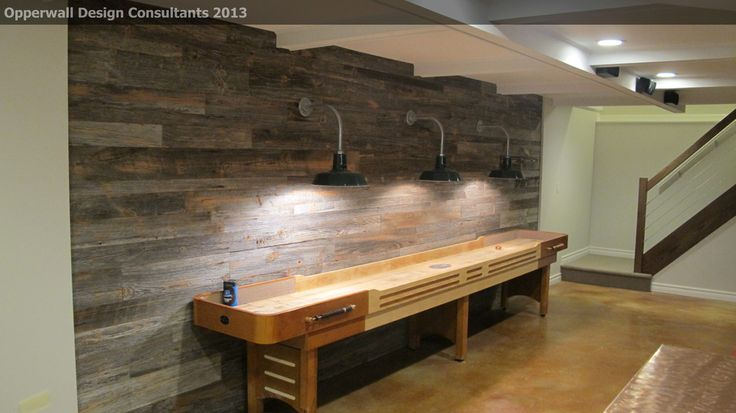 Impressive shuffleboard table in Basement Farmhouse with Barn Wood Wall next to Pallet Wall alongside Game Table and Wood Walls