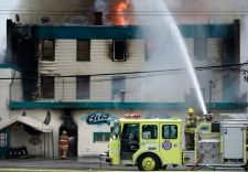 Firefighters hose down a fire that broke out in the historic Columbus Hotel in…