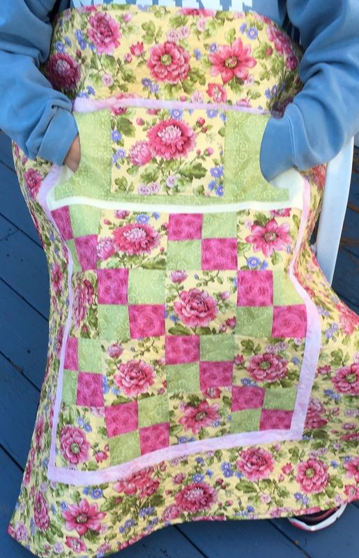 """Find handmade wheelchair lap quilts from Carolyn's Homesewn in NH. Our signature """"lovie lap quilts"""" feature pockets for extra warmth and storage. Click to shop today!"""