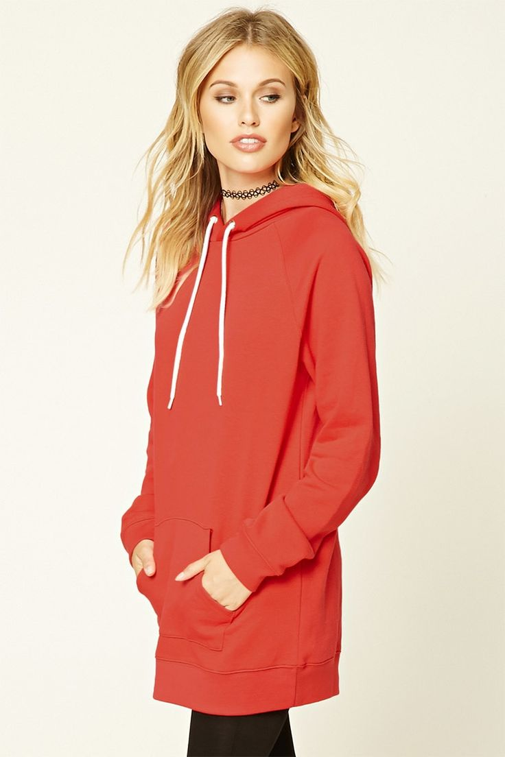 An oversized cotton blend tunic sweater featuring a drawstring hood, long raglan sleeves, and a front kangaroo pocket.