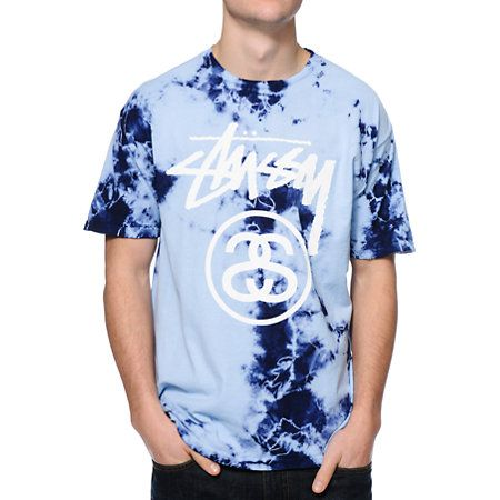Grab nothing but good vibes in the comfortable and groovy Stussy Storm Stock Link blue tie dye tee shirt. Get ready for summer festivals and hang outs with the rad blue and navy tie dye colorway with a white Stussy script and SS link logo graphic at the c