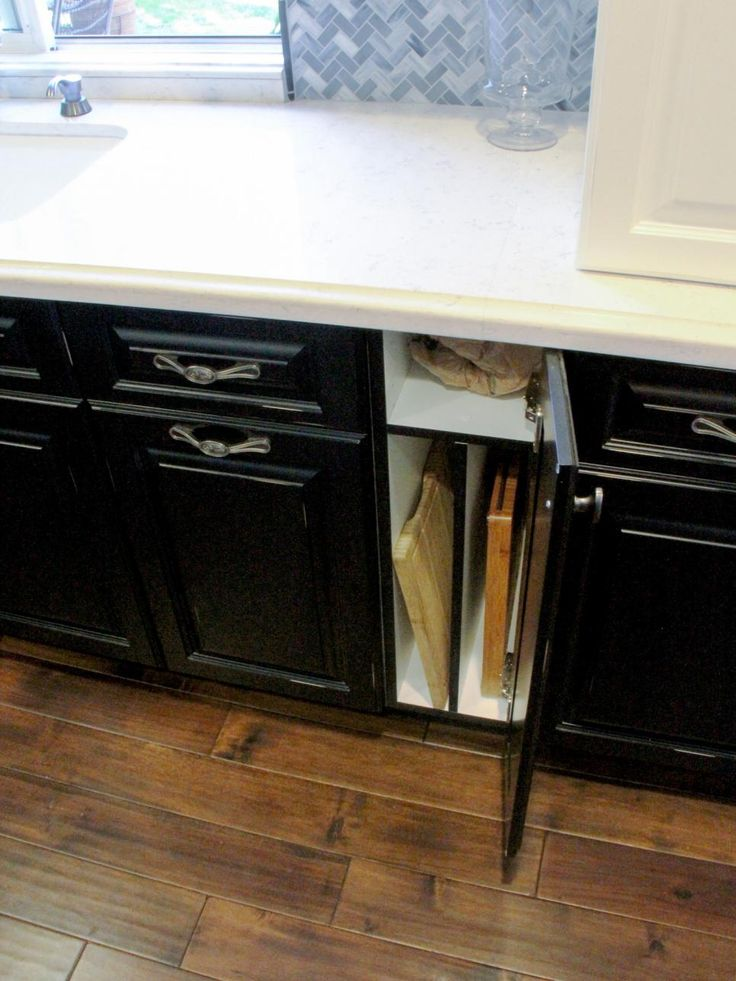 Vertical cabinets make storing and organizing cutting boards, cookie sheets and other tall, skinny items a breeze.