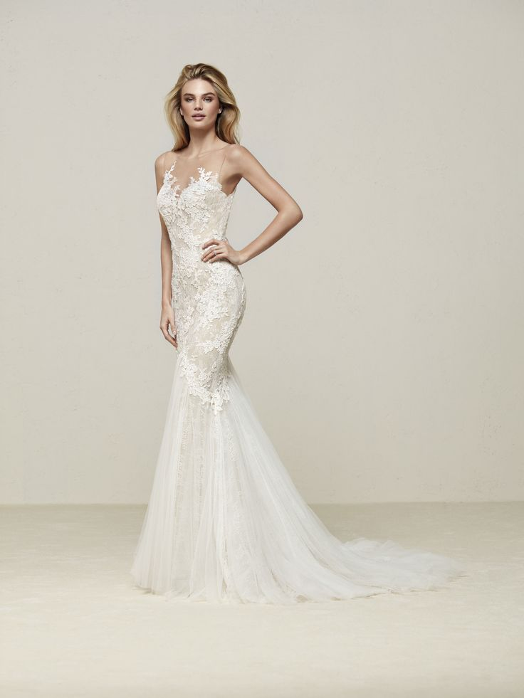 Pronovias 2018 Style DRINEA     Flower blossoms directly on  the skin on this beautiful mermaid dress, in Tulle and Chantilly lace appliqués. The illusion blends into the back, creating a spectecular tattoo effect. Also, Guipure lace travels down the body and hip, into a beautiful drop skirt in soft Tulle.