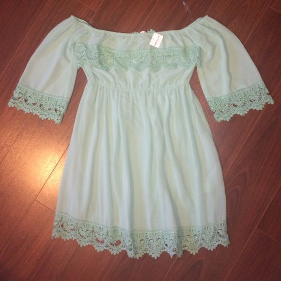 Mint green Off the shoulder Dress NEW WITH TAGS! Mint green off the shoulder dress with lace details. Clinched waist. Purchased from Apricot Lane and never worn! Apricot Lane Dresses