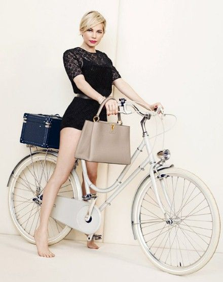 Michelle Williams for LV campaign sporting beige bag and black romper on a lovely white bicycle more velondonista.com