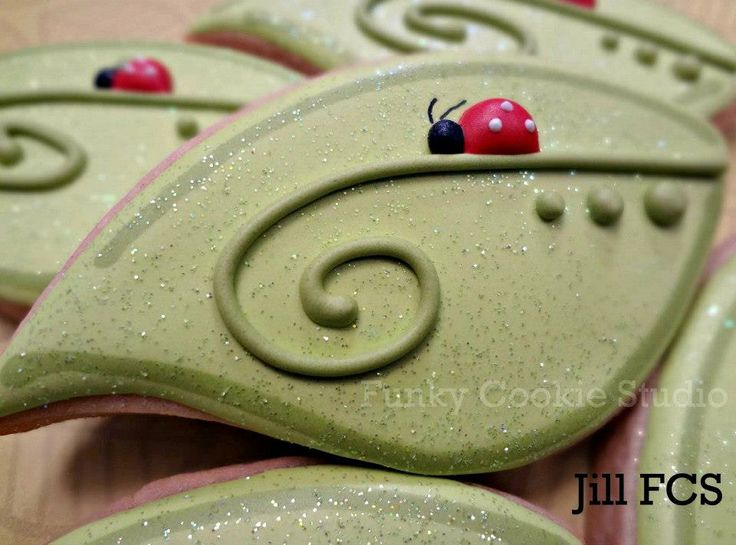 Cute Ladybug on leaf Cookie by Jill's Funky Cookie Studio