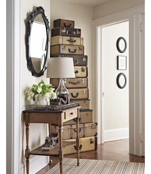 Stack antique suitcases and then use them as 'drawers' to increase storage space in tight corners.