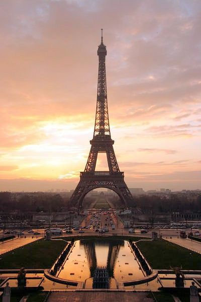 La Tour Eiffel sunset. Take in the beautiful skies of Paris –