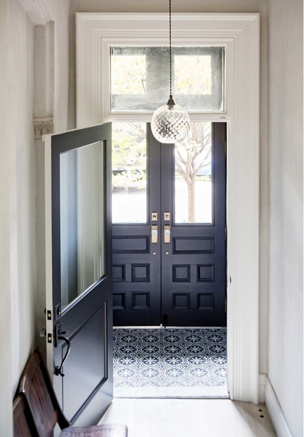black doors, cement tiles + cut glass pendant lamp in the foyer
