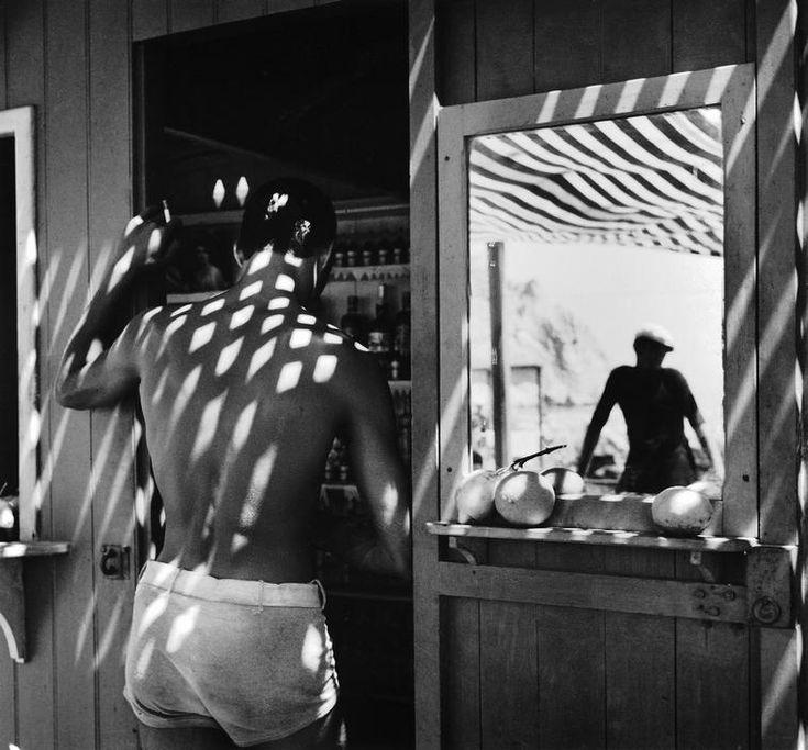 by Herbert List - At the beach bar. San Angelo, Island of Ischia, Italy, 1933.