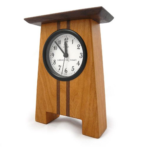 Craftsman Desk Clock. Reminiscent of the American Arts and Crafts Style, the Craftsman Desk Clock is precisely crafted with solid cherry and walnut wood, provided with a hand-rubbed oil finish. The natural kiln-dried woods are native to the Appalachian Mountains and certified sustainable. US-made quartz timepiece accepts a single AA battery. Designed and made in North Carolina.