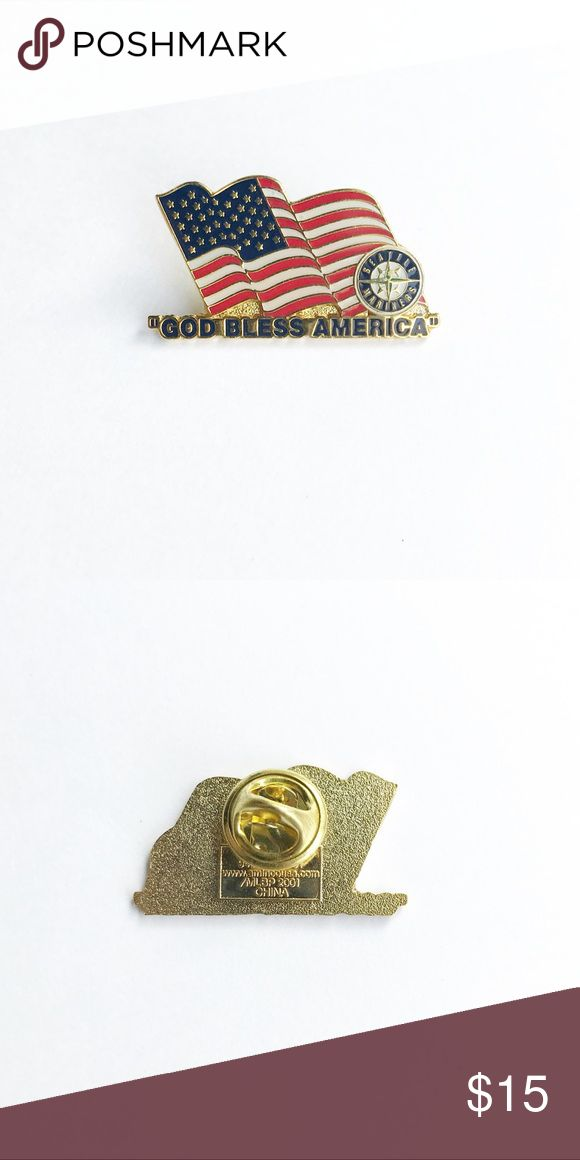 "Seattle Mariners ""God Bless America"" Pin 2001 Seattle Mariners ""God Bless America"" Enamel Pin  • 1  1/4"" x 3/4"" • colors: gold, red, white, blue • tags: major league baseball, MLB, bat, fan, swing, pitcher, national anthem, song, championship, pnw, home run, team, club, game, hall of famer, American Flag, America, USA, player, bag, backpack, vest, jacket, hat, lapel, brooch • all of the pins I sell are vintage and may contain minor nicks, imperfections, or oxidation Vintage Accessories"