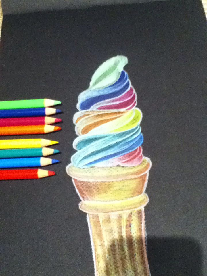 A rainbow ice-cream. I wish I could eat it. I love this one. Ice-cream on black paper.