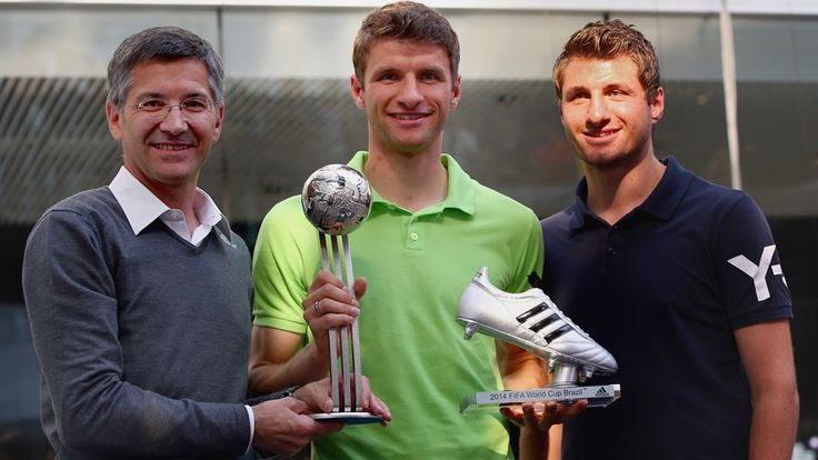 Thomas Mueller (C), Herbert Hainer, CEO adidas group (L) and his Brother Simon Mueller (R)