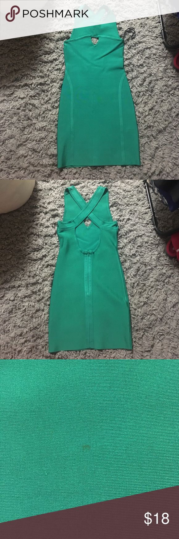 Bebe bodycon with criss cross back dress Cute jade green bodycon dress from Bebe. Only worn a few times and looks brand new. Has a keyhole in the front, criss cross straps in the back and then opens up, has a hook and eye zipper closure in the back. There is a small stain on the front but it is t even noticeable, just a very very tiny spot. Perfect for a night out! bebe Dresses Mini
