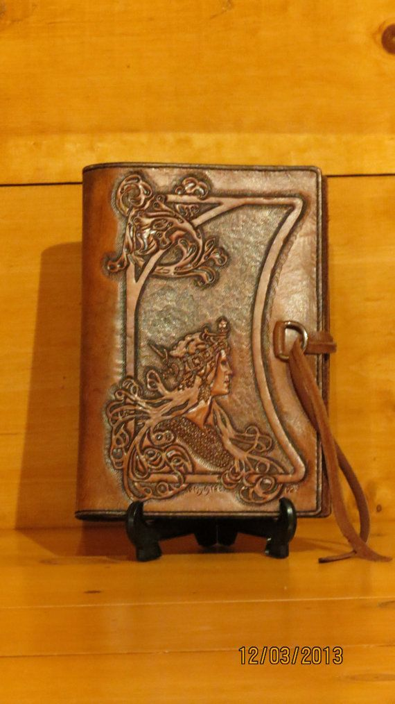 Hand carved, tooled and stitched leather book cover.