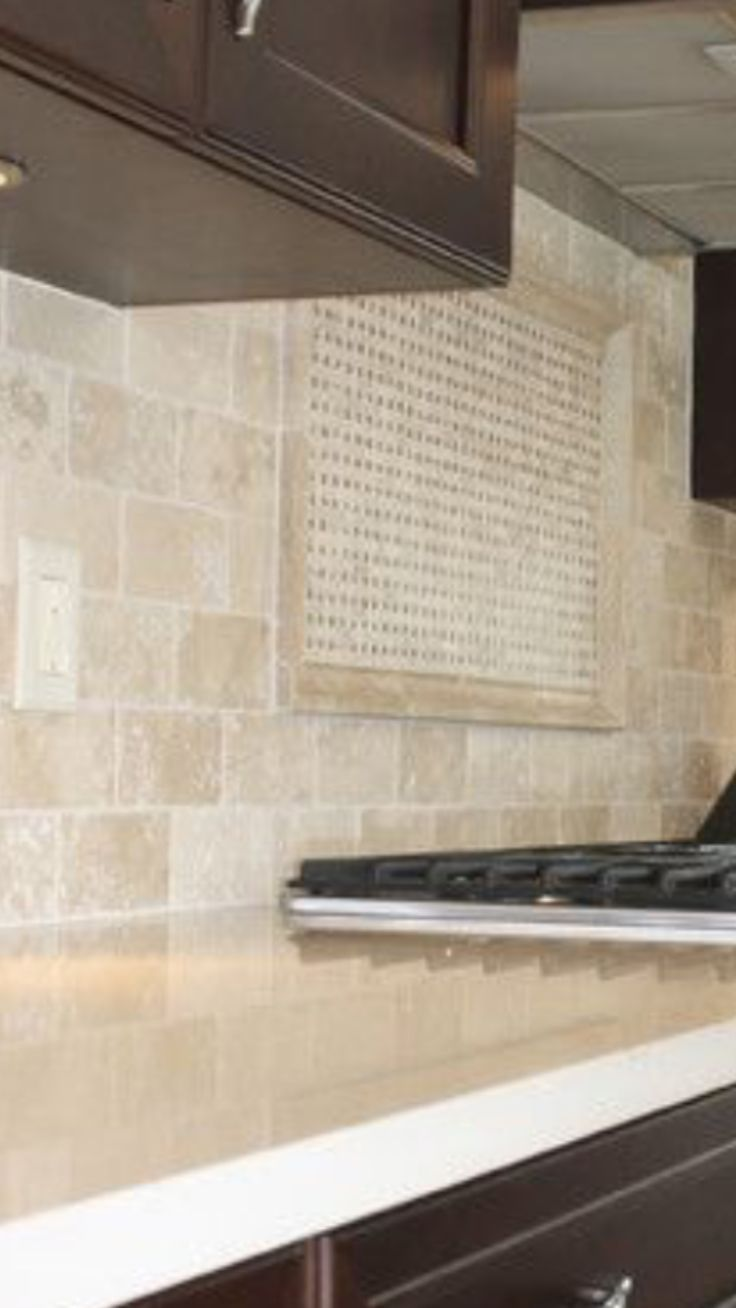 Travertine Backsplash With White Quartz Countertop