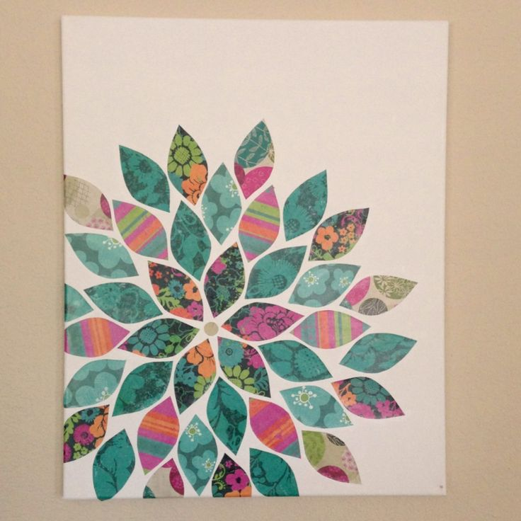 Scrapbook paper on a canvas -- love the flower! Such a great idea! example set off center. (I still like the black background you shared, better)