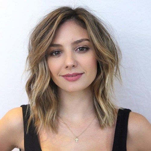 Medium Layered Haircut For Square Face/A square face shape is actually the easiest to work with when it comes to finding the right cut. You're not trying to hide or add anything, but are instead showing off your excellent bone structure. This choppy piecey lob softens the strong chin and reveals the high cheek bones.