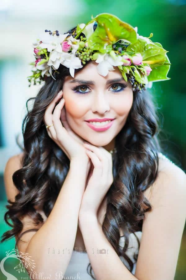 To achieve this garden style we've used a wide variety of flowers including midori anthuriums, green trick, spray roses, snapdragons, glasshouse roses, singapore orchids, canterbury bells and privet berry. I adore the blue-black sprigs of privet berry delicately draping across the bouquet and especially the circlet – they match her eye makeup perfectly, with the midori anthuriums giving that real pop of vibrancy from behind…