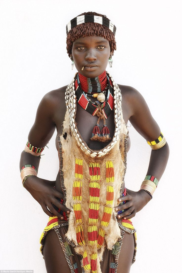 A young woman from the Hamar tribe in Ethiopia wearing an animal skin and elaborate beaded jewellery
