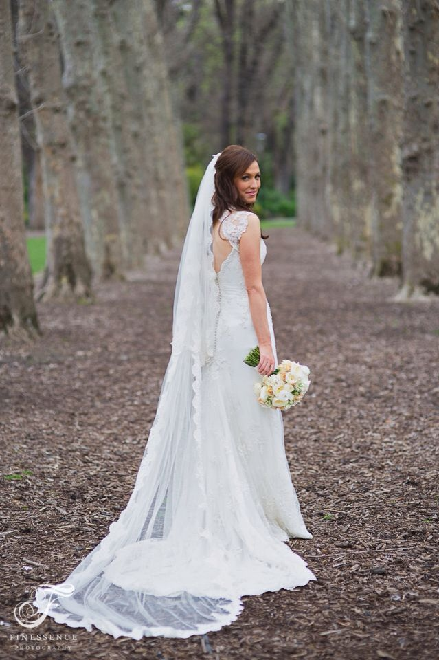 Our bride in front of the infamous line of trees in melbourne city  // Melbourne Wedding photography by Finessence // www.finessence.com.au