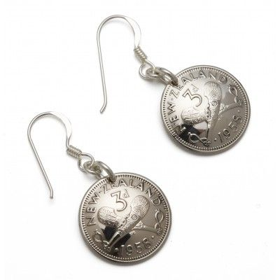 Vintage Coin Earrings Three Pence. These three pence coin earrings are hand crafted from vintage New Zealand coins with Stirling silver hooks. The three pence is approximately 16mm in diameter and features two crossed traditional Maori clubs on the front and King George the Sixth on the back. The perfect gift or souvenir for avid travellers, ex-pat Kiwis and teens. These earrings are made in New Zealand from vintage currency no longer in circulation.  See more at www.entirelynz.co.nz/gifts