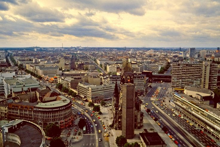 https://flic.kr/p/3aukDr   Downtown Berlin from the Europa Center   The center is the Kaiser Wilhelm Gedächtniskirche - of note are the red canopies of the world's largest Burger King on the AEG building at 224 Kurfurstendamm at the lower left - all 3 floors of it! The Kurfurstendamm is the street curving to the left. ☺
