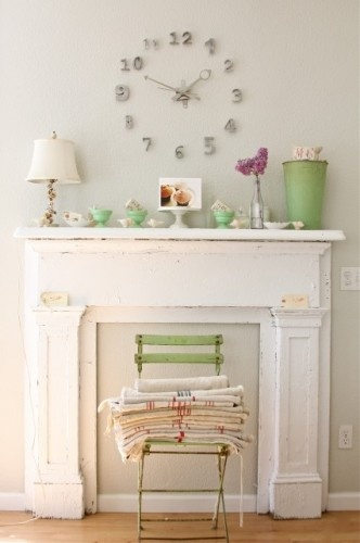 Here is an idea to warm up your master bedroom..  find an old fireplace mantel from a thrift store, add a little paint, install and enjoy..  Faux fireplaces can be just as lovely as the real thing