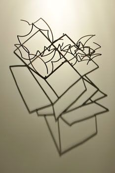 larry kagan sculpture. you are seeing the sculpture and it's shadow together to make the image.