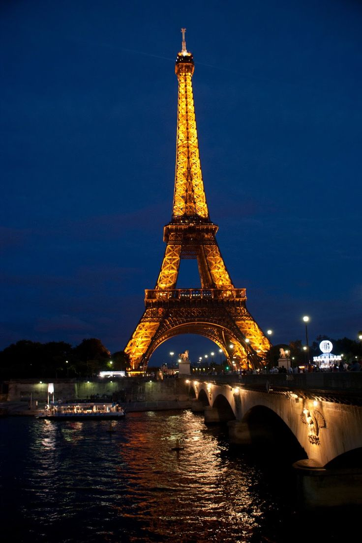 The Eiffel Tower and the river Seine in the night