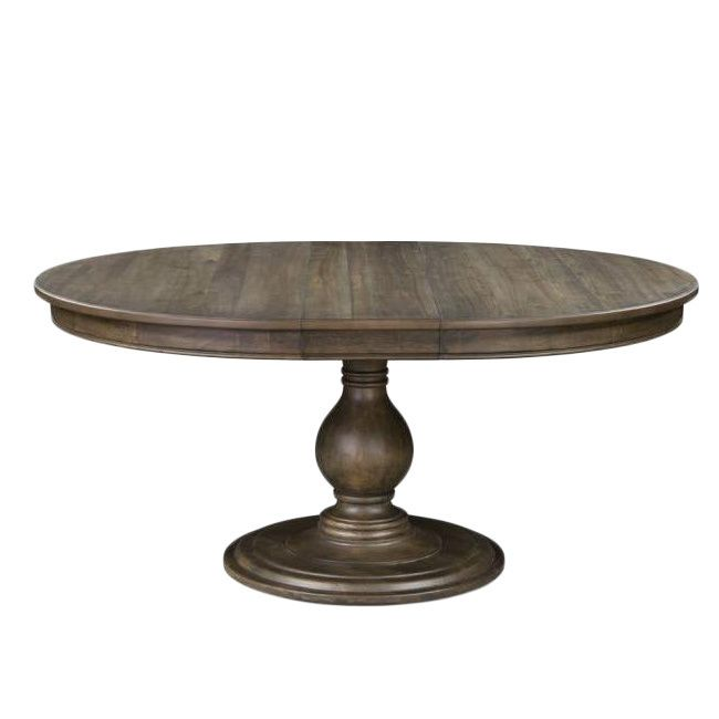 Made of hardwood solids covered with a dry gray acacia veneer, this table offers beauty in both form and function. The round shape is perfect for fellowship with friends, while an extension leaf means you can add a few more people to the group.