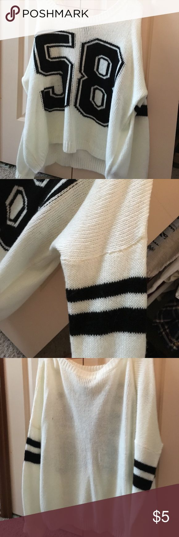 Forever 21 Sweater White sweater with black numbers 58, and black stripes on the sleeves. Never been worn. Forever 21 Sweaters Crew & Scoop Necks
