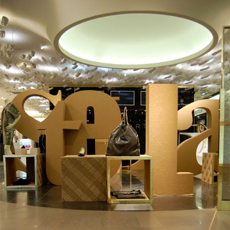 London designer Giles Miller has created a pop-up shop for Stella McCartney, spelling out the fashion designer's name in two metre-high cardboard lettering.
