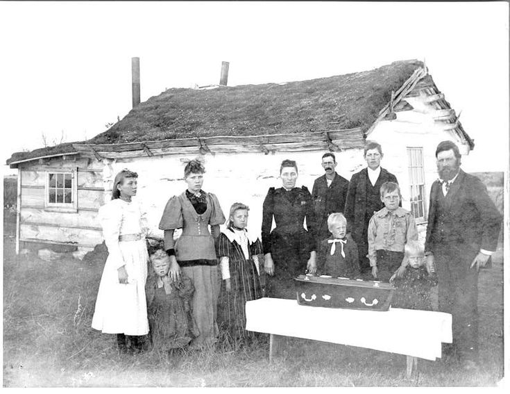 A Funeral in days gone by...note the size of the casket.