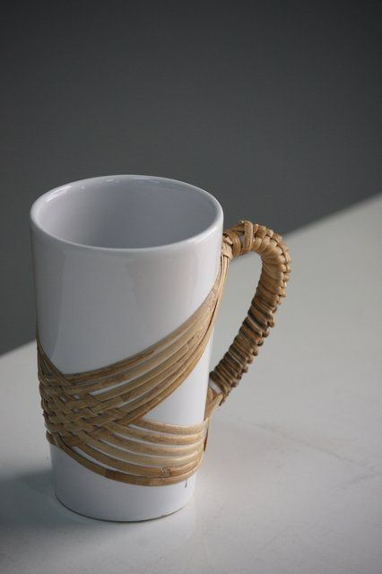 Handcrafted mugs with rattan weaving - neat idea, but I'd never want to use it because you'd have to wash it.
